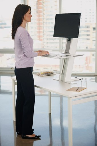 human scale sit stand keyboard tray and monitor arm