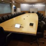 30 foot Maple Board Room Table and 3 U Shaped Modular Conference tables .